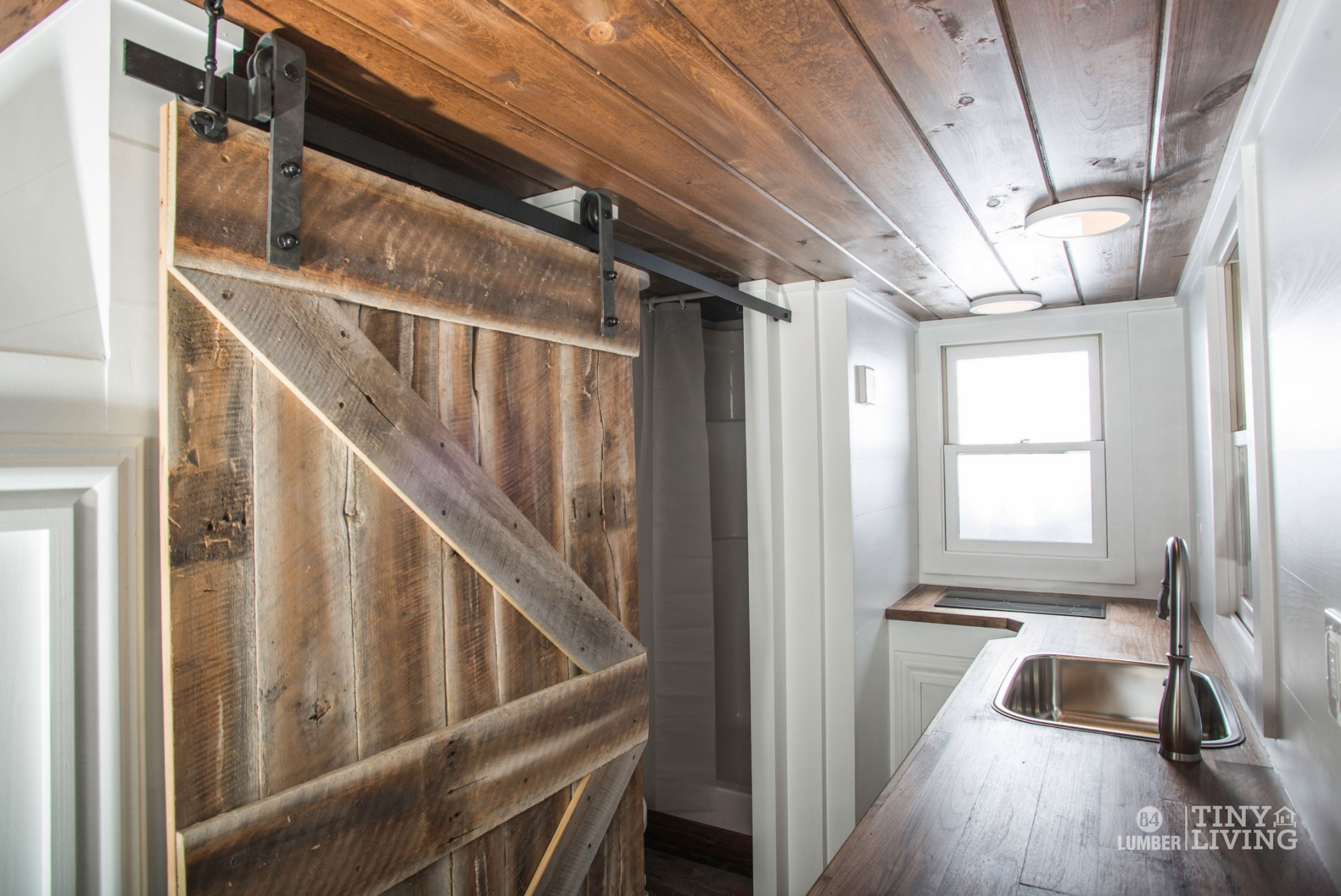 Tiny home kitchen - The Roving Kitchen And Rolling Door By 84 Tiny Houses 84 Lumber